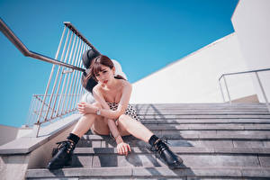 Images Asian Stairs Sitting Legs Glance young woman