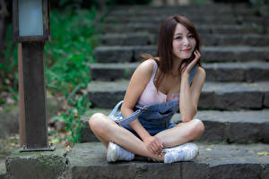Desktop wallpapers Asian Stairs Sit Pose Smile Staring young woman