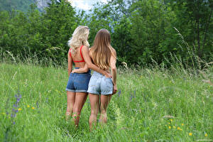 Image Cara Mell Back view Grass Shorts Two Hug Ass buttocks Stefani young woman
