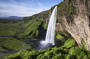 Desktop wallpapers Iceland Waterfalls Grass Rock Seljalandsfoss, South Iceland Nature