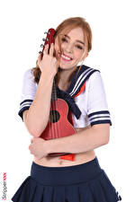 Photo Jia Lissa Musical Instruments Uniform Guitar Brown haired Staring Smile Hands Skirt Hug Schoolgirl young woman