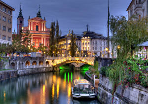 Images Ljubljana Slovenia River Bridge Riverboat Night time Ljubljanica river Cities