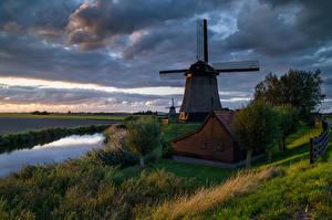 Pictures Netherlands Houses Rivers Evening Windmills Trees Schermerhorn Nature