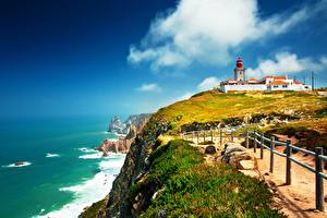 Images Portugal Coast Stones Lighthouses Grass Fence Cape Rock, Cabo da Roca Lighthouse Nature