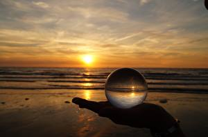 Pictures Sunrise and sunset Beach Hands Glass Balls