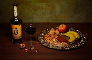 Desktop wallpapers Wine Bananas Apples Walnut Nuts Bottle Stemware Food
