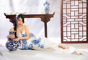 Images Asian Laying Frock Vase Staring female