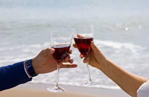Pictures Closeup Wine Blurred background Hands Stemware