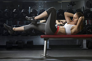 Images Fitness Bench Uniform Lying down Workout Hands Legs female Sport