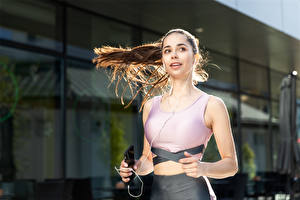 Pictures Fitness Bokeh Smartphone Headphones Brown haired Glance Hands Running Hair young woman