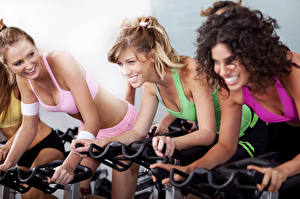 Desktop wallpapers Fitness Curly Three 3 Blonde girl Smile Workout Girls