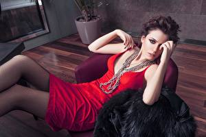 Desktop wallpapers Jewelry Brown haired Lying down Staring Hands Chain Dress Pantyhose Girls