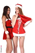 Fondos de Pantalla Jia Lissa Liya Silver iStripper Año Nuevo El fondo blanco Uniforme Dos Cabello castaño Sombrero del invierno Mano Pierna Chicas imágenes