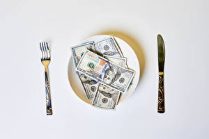 Photo Knife Money Dollars Banknotes Gray background Plate Fork