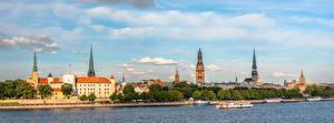 Bureaubladachtergronden Letland Rivier Panoramische Waterfront Riga Steden