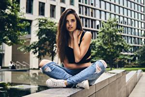 Photo Lotus position Brunette girl Posing Sitting Hands Jeans Bokeh young woman
