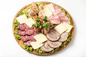 Photo Meat products Sausage Ham Cheese Vegetables White background Cutting board Sliced food