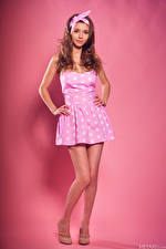 Desktop wallpapers Mila Azul Brown haired Gown Pose Bowknot Staring Pink background female