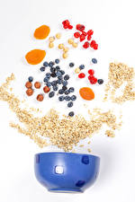 Pictures Oatmeal Blueberries Hazelnut Apricot White background Grain Dried fruit