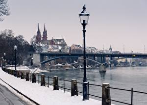 Images Rivers Bridges Switzerland Winter Fence Street lights Snow Basel, Rhine, Munster Cities