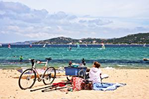 Images Sea Surfing Beaches Bicycle Sand Brown haired Glasses Sitting Windsurfing young woman Nature