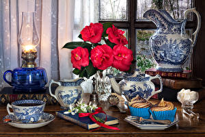 Image Still-life Begonia Paraffin lamp Little cakes Galanthus Jug container Red Cup Book Sugar Food Flowers