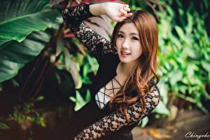 Pictures Asian Bokeh Brown haired Staring Hands young woman