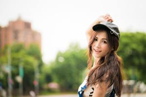 Images Asian Bokeh Brown haired Staring Hands Baseball cap Smile Girls