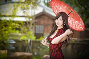 Wallpaper Asian Blurred background Parasol Glance Smile Hands Brown haired young woman