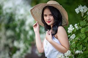 Images Asian Blurred background Hat Brunette girl Glance Hands Vietnamese female