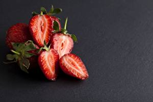 Photo Berry Strawberry Gray background Red Sliced food Food