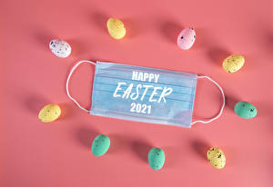 Image Easter Coronavirus Masks Colored background Eggs Multicolor Lettering English 2021 Food