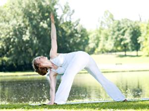 Photo Fitness Yoga Grass Pose Brown haired Workout Hands Legs female