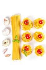 Pictures Allium sativum Tomatoes White background Pasta Food