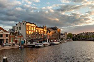 Desktop wallpapers Netherlands Houses Riverboat Rivers Waterfront Clouds Spaarne river, Haarlem Cities