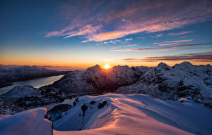 Wallpaper Norway Lofoten Mountain Sunrises and sunsets Fjord Sun Snow
