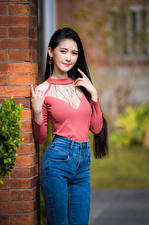 Pictures Asian Bokeh Posing Brunette girl Smile Jeans Blouse Glance female