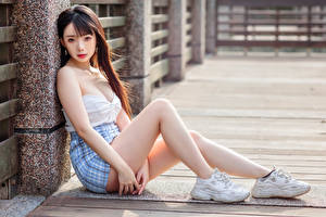 Pictures Asian Sit Legs Skirt Staring Brown haired young woman