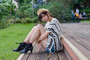 Picture Asian Sitting Pose Legs Beret Glance young woman