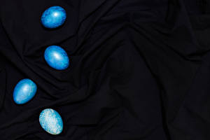 Desktop wallpapers Easter Eggs Light Blue Template greeting card Black background Cloth Flowers