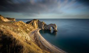 Desktop hintergrundbilder England Küste Felsen Bogen architektur Dorset Natur