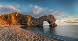 Hintergrundbilder England Küste Felsen Bogen architektur Strand Dorset Natur