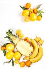 Photo Fruit Bananas Lemons Pineapples Mandarine White background