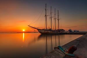 Desktop hintergrundbilder Seebrücke Schiff Sonnenaufgänge und Sonnenuntergänge Sonne Natur