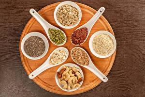 Bilder Schalenobst Grüne Erbsen Reis Buchweizen Haferbrei Schneidebrett Löffel Getreide Lebensmittel