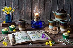 Wallpaper Still-life Daffodils Galanthus Kerosene lamp Little cakes Walls Boards Vase Book Mug Food