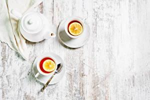 Fotos & Bilder Tee Zitrone Bretter Zwei Tasse Löffel Lebensmittel
