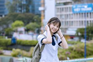 Photo Asian Bokeh Brunette girl Glance Smile Hands Vietnamese young woman
