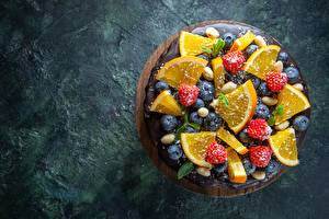 Fotos & Bilder Torte Orange Frucht Himbeeren Heidelbeeren Lebensmittel