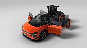 Images CUV Orange Metallic Chinese Opened door From above Gray background HiPhi X, 2020 auto